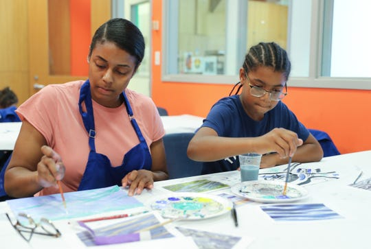 Angela Simmons, left, and Justin Headley, 9, from Peekskill work on their paintings at family art class at the Hudson River Museum in Yonkers on Saturday, July 28, 2018.