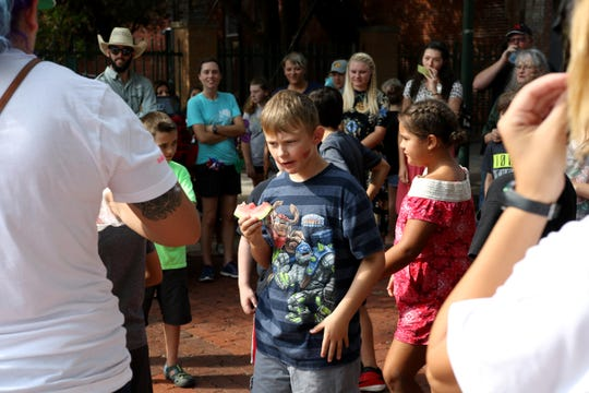 Kids gather for the watermelon seed spitting contest at Watermelon Day Saturday, July 28, 2018, at the downtown Wichita Falls Farmers Market.