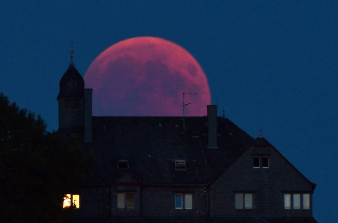 The moon turns red during a total lunar eclipse in Bernkastel-Kues, Germany, July 27, 2018.
