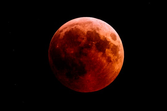 The full moon during a 'blood moon' eclipse as seen from the town of Kazanlak, Bulgaria, on July 27, 2018.