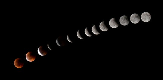 This combination of 14 photos shows the moon during a total lunar eclipse near the Canary Islands on July 27, 2018.