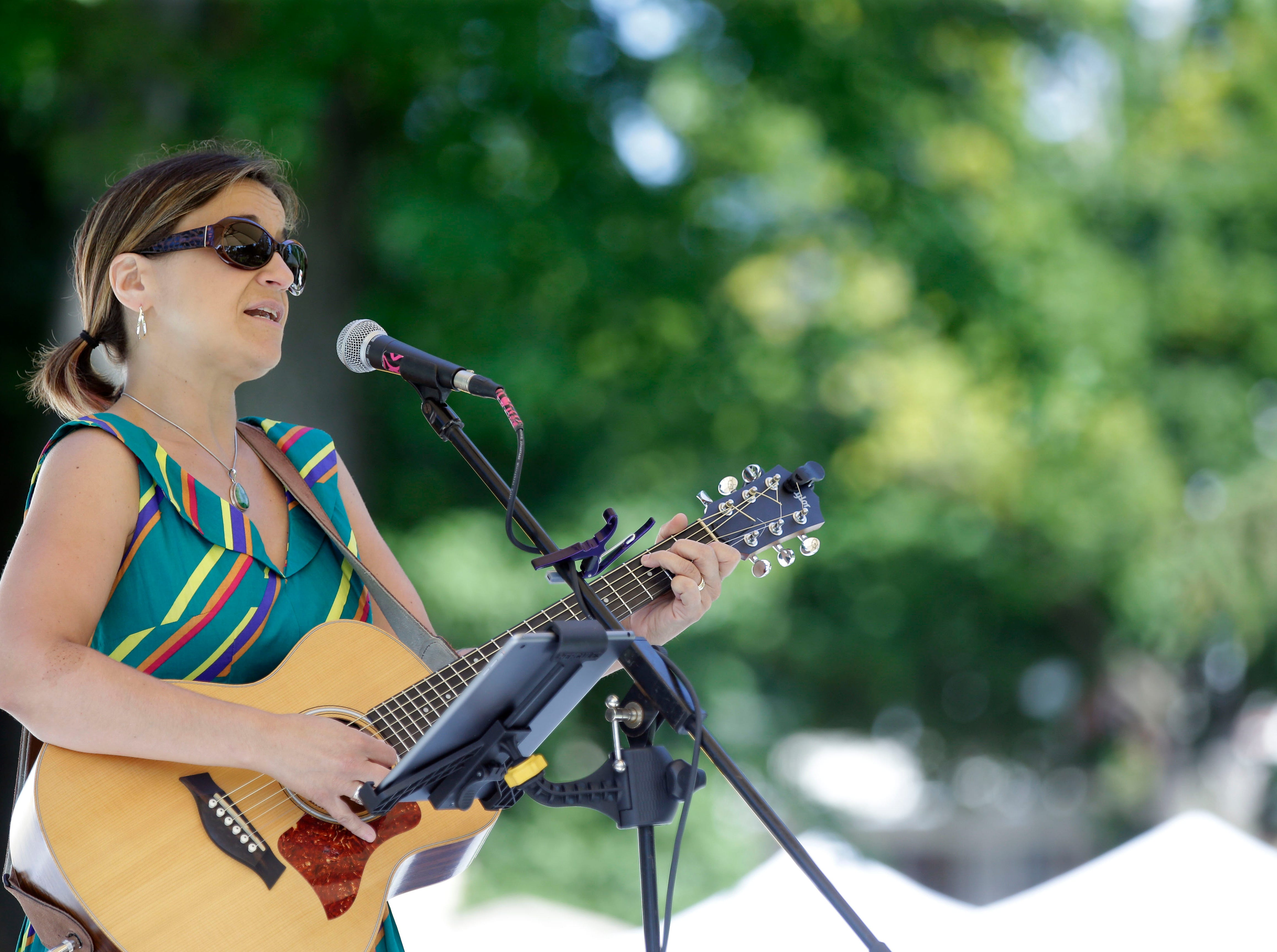 Adria Ramos performs as the 58th annual Art at the Park takes place Sunday, July 29, 2018, at City Park in Appleton, Wis.Ron Page/USA TODAY NETWORK-Wisconsin