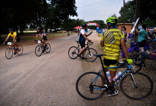Riders relax and encourage each other as contestants cross the finish line Saturday at the Old Settlers Reunion Grounds in Buffalo Gap during the Tour de Gap.