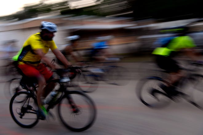 Bicyclists are blurred as they pedal through Buffalo Gap during the 2018 Tour de Gap bicycle race.