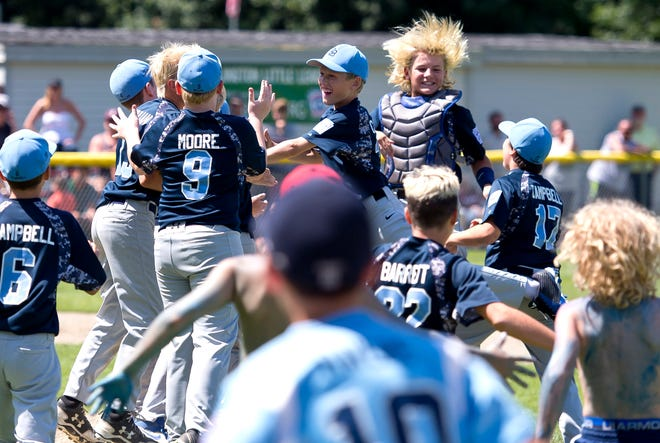South Burlington players and fans storm the field after the final out of their 3-1 win over Lyndon in Sunday's decisive Little League baseball championship game at Schifilliti Field.