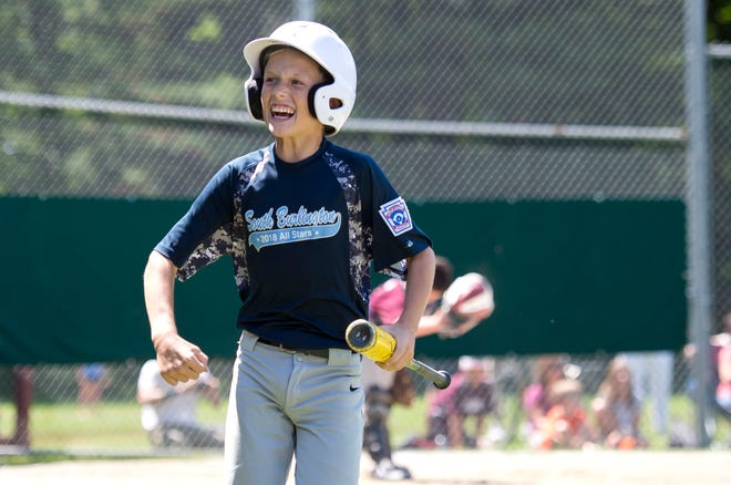 South Burlington's Ryan Carpenter celebrates after scoring a run in the fourth inning of Sunday's decisive Little League baseball championship game at Schifilliti Field.