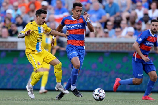 FC Cincinnati midfielder Will Seymore (8) dribbles the ball forward in the first half during an international friendly match between RCD Espanyol and FC Cincinnati, Saturday, July 28, 2018, at Nippert Stadium in Cincinnati.