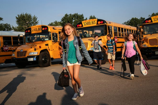 Fifth- and sixth-grade students arrive at E.H. Greene Intermediate for the first day of school in September 2017.
