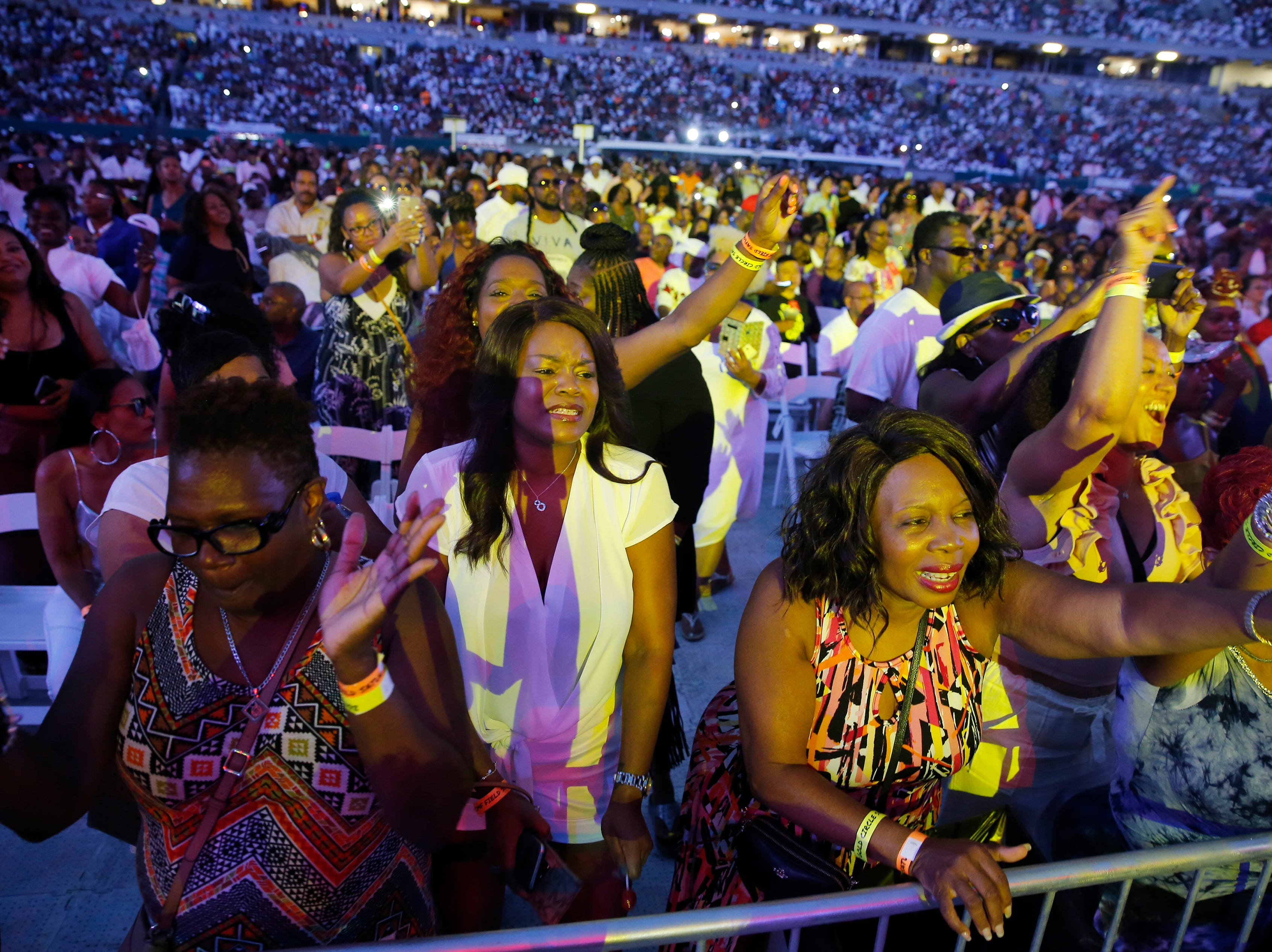 Music lovers sing along with Keith Sweat during the Cincinnati Music Festival.