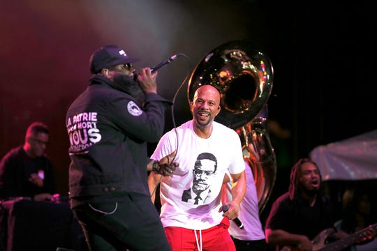 Hip-hop artist Black Thought of The Roots, left, and  Common perform during the Cincinnati Music Festival.