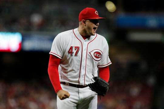 Cincinnati Reds relief pitcher Sal Romano (47) celebrates after the third out of the top of the seventh inning of the MLB National League game between the Cincinnati Reds and the Philadelphia Phillies at Great American Ball Park in downtown Cincinnati on Saturday, July 28, 2018.