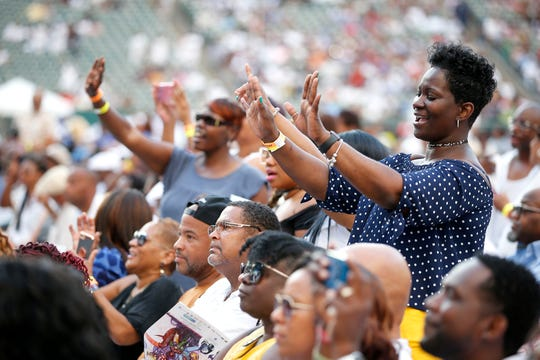 LaDiva Young of Chicago sings along with The O'Jays during the Cincinnati Music Festival.