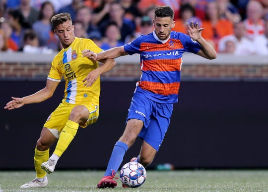 FC Cincinnati midfielder Nazmi Albadawi (5) battles for position in the second half during an international friendly match between RCD Espanyol and FC Cincinnati, Saturday, July 28, 2018, at Nippert Stadium in Cincinnati.