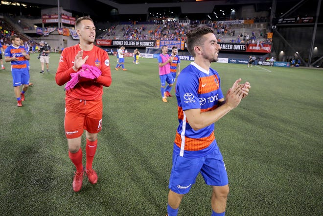 FC Cincinnati goalkeeper Mark Village (17), left, and FC Cincinnati midfielder Tyler Gibson (4) thank the crowd after an international friendly match between RCD Espanyol and FC Cincinnati, Saturday, July 28, 2018, at Nippert Stadium in Cincinnati.