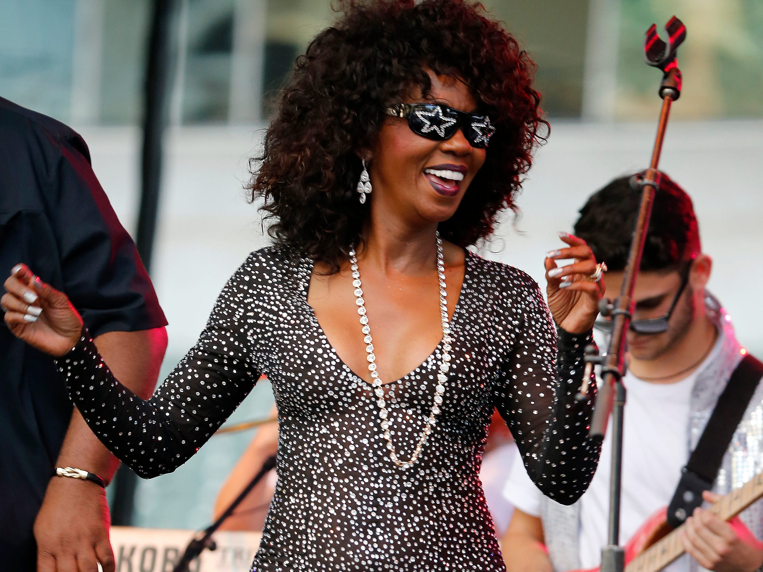 Patti Collins dances on stage as her husband Bootsy Collins performs during the Cincinnati Music Festival.