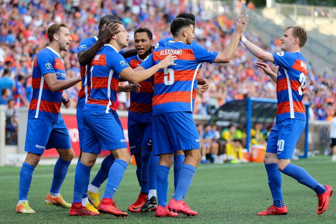 FC Cincinnati forward Russell Cicerone (7), second from left, is congratulated after scoring in the first half during an international friendly match between RCD Espanyol and FC Cincinnati, Saturday, July 28, 2018, at Nippert Stadium in Cincinnati.