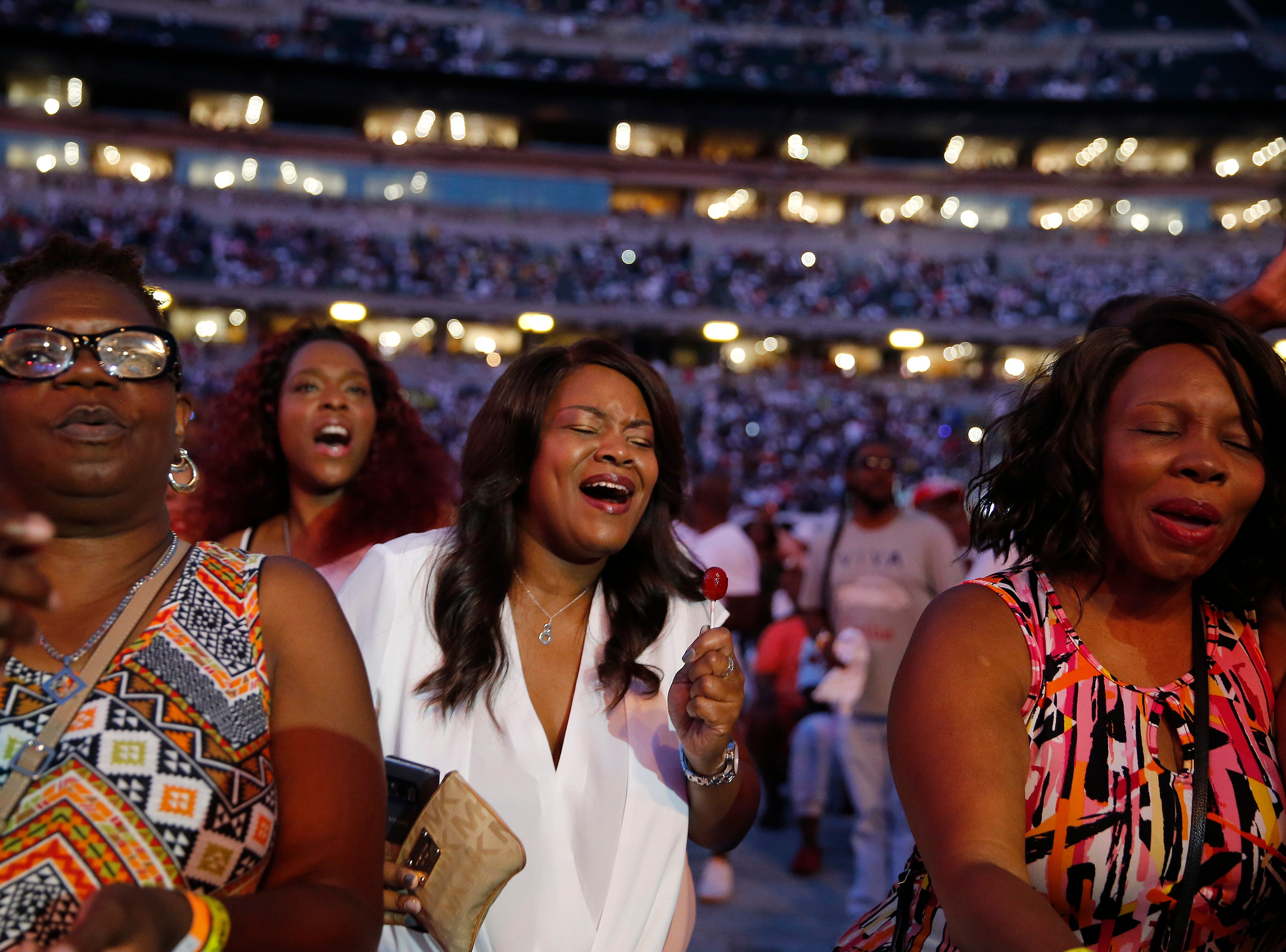 Fans sing along with Keith Sweat as he performs during the Cincinnati Music Festival.