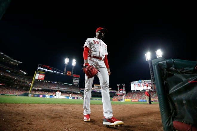 Cincinnati Reds relief pitcher Amir Garrett (50) returns to the dugout after being pulled in the eighth inning of the MLB National League game between the Cincinnati Reds and the Philadelphia Phillies at Great American Ball Park in downtown Cincinnati on Saturday, July 28, 2018.
