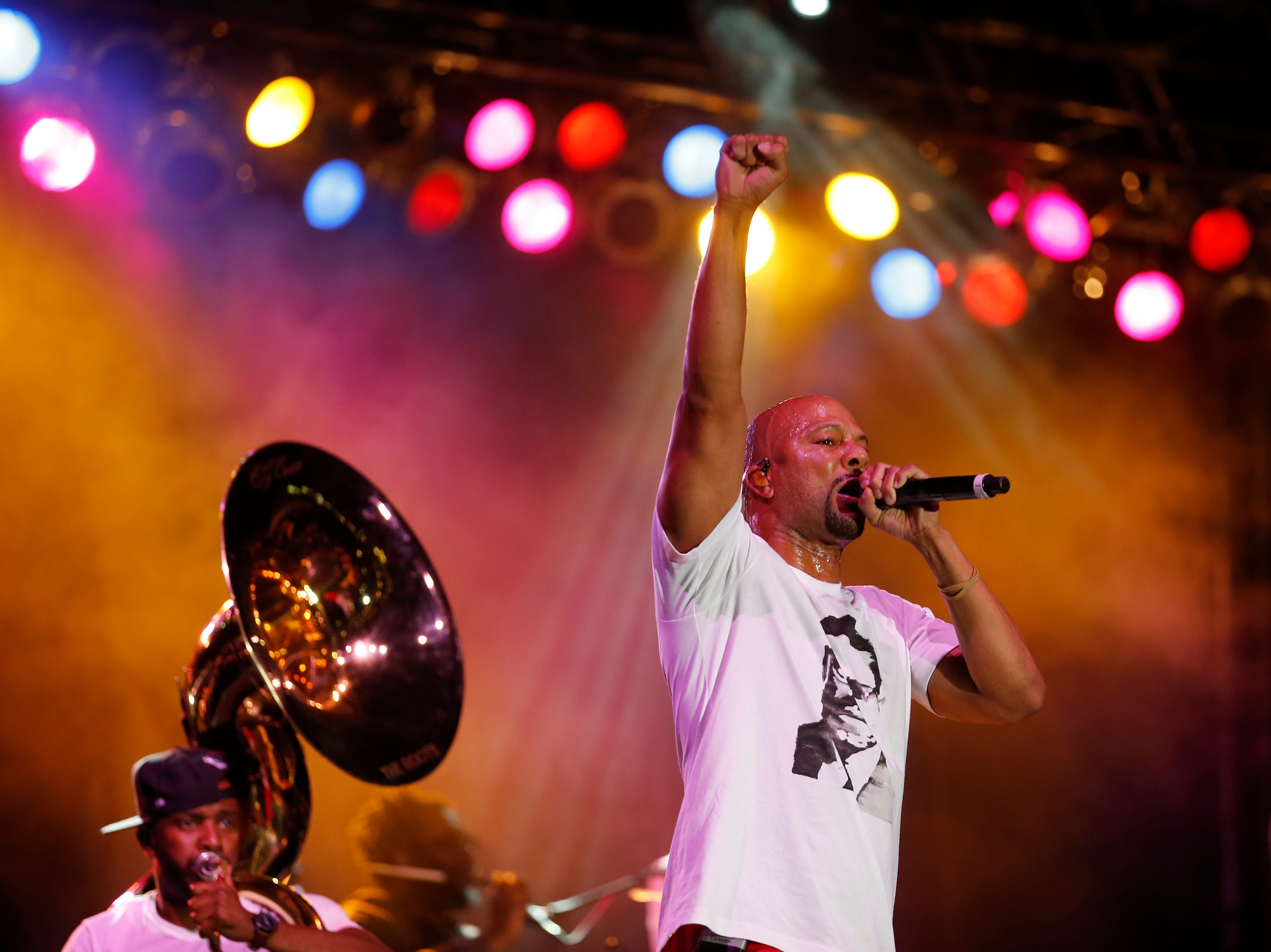 Hip-hop artist Common performs with The Roots during the Cincinnati Music Festival.