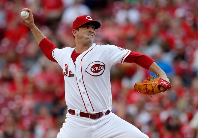 Cincinnati Reds starting pitcher Matt Harvey (32) delivers a pitch in the top of the first inning of the MLB National League game between the Cincinnati Reds and the Philadelphia Phillies at Great American Ball Park in downtown Cincinnati on Saturday, July 28, 2018.