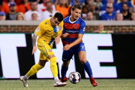 FC Cincinnati forward Russell Cicerone (7) is taken down in the second half during an international friendly match between RCD Espanyol and FC Cincinnati, Saturday, July 28, 2018, at Nippert Stadium in Cincinnati.
