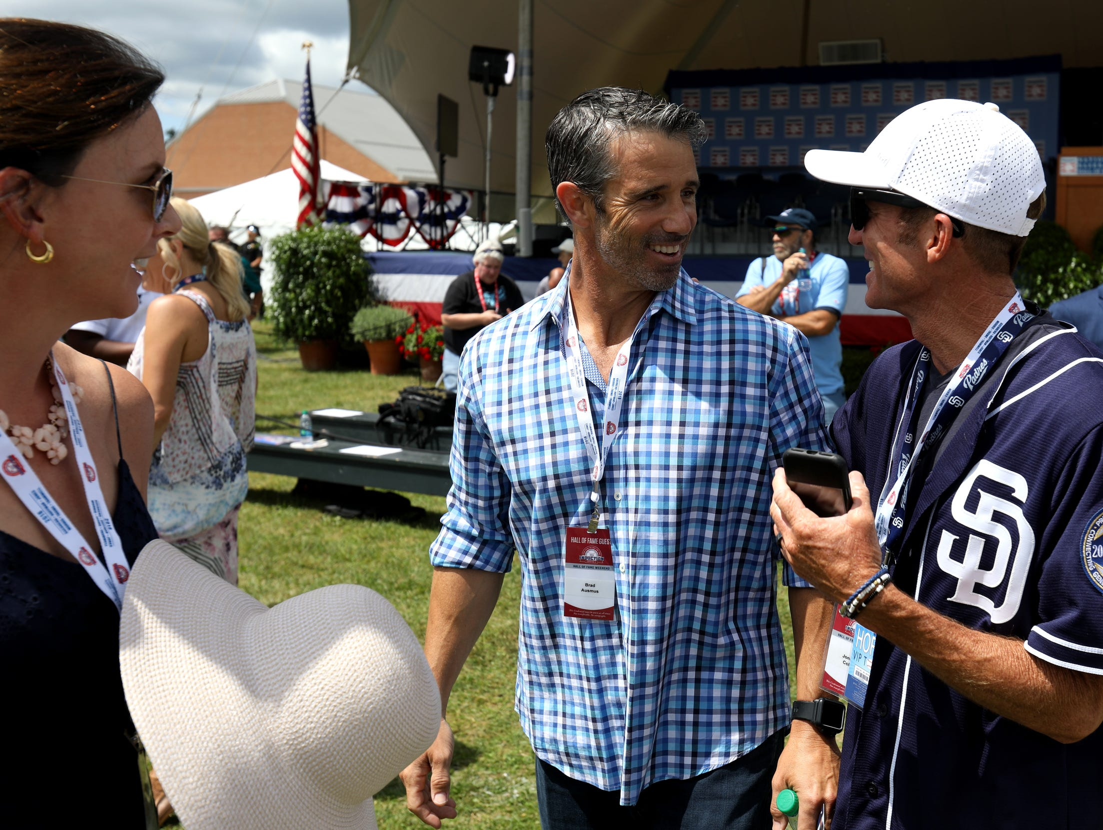 Former Detroit Tigers player and manager Brad Ausmus talks with friends before the start of the Baseball Hall of Fame induction ceremony at the Clark Sports Center after the National Baseball Hall of Fame induction ceremony in Cooperstown, N.Y. on Sunday, July 29, 2018.