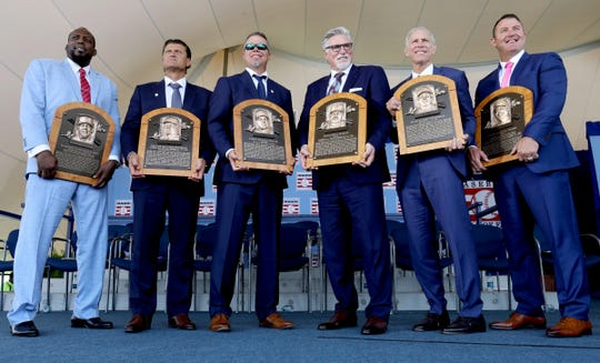 (From left) The Baseball Hall of Fame Class of 2018 with their plaques: Vladimir Guerrero, Trevor Hoffman, Chipper Jones, Jack Morris, Alan Trammell and Jim Thome.