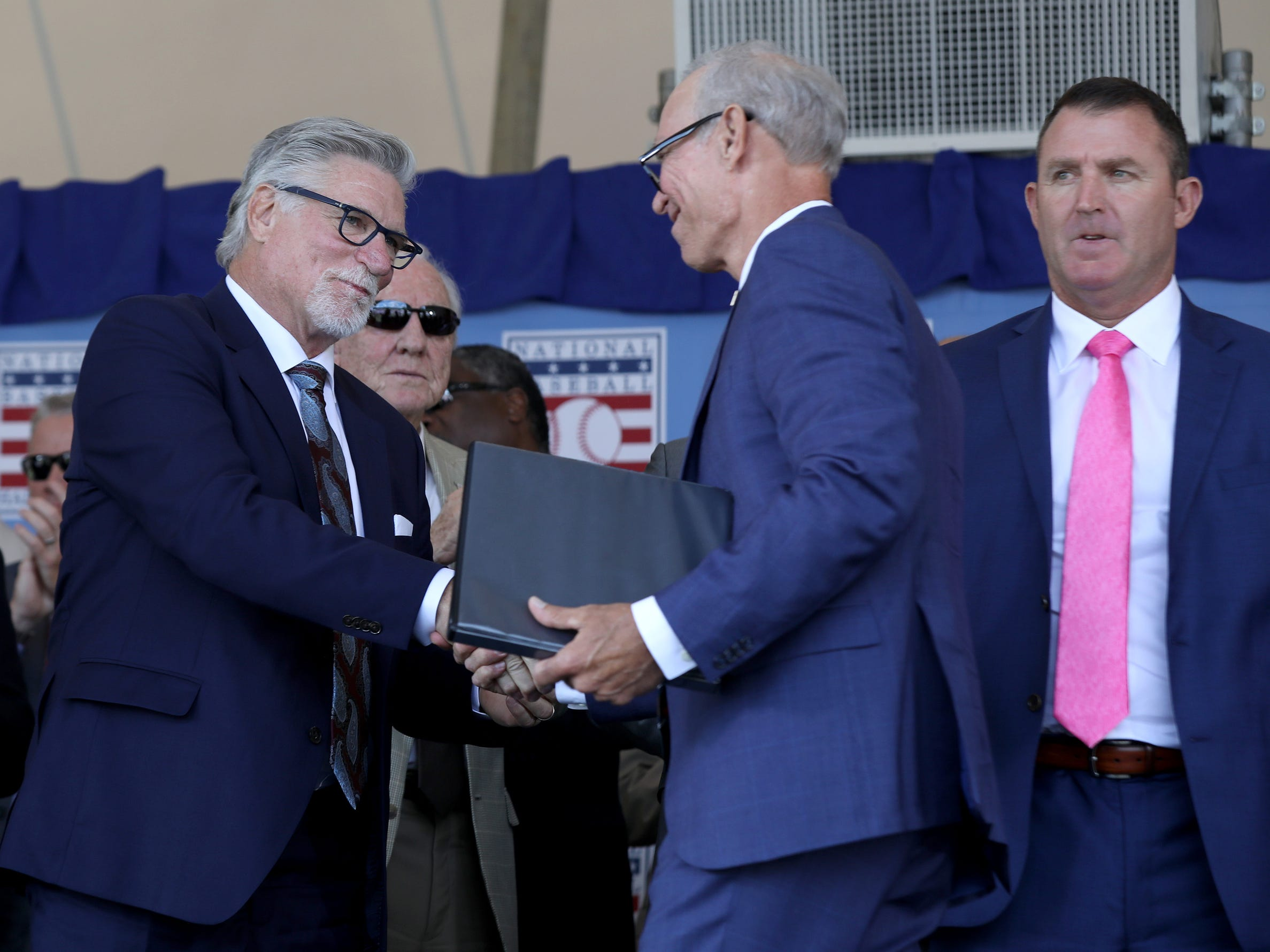 Detroit Tigers' Jack Morris, left, shakes hands with his former teammate Alan Trammell, after Trammell finished his National Baseball Hall of Fame induction speech at the Clark Sports Center in Cooperstown, N.Y. on Sunday, July 29, 2018.