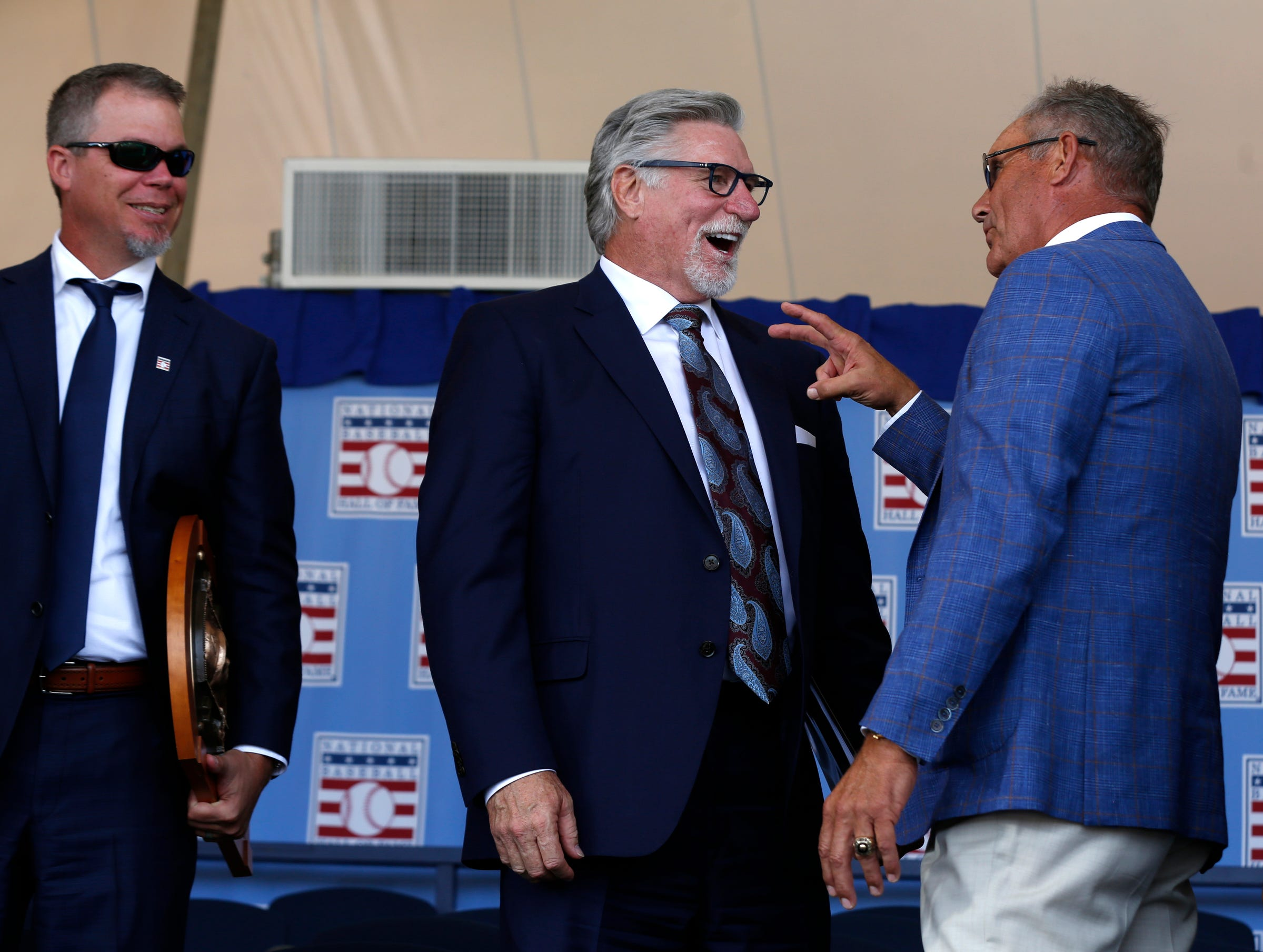 As newest Baseball Hall of Fame member and Atlanta Braves great Chipper Jones looks on fellow inductee Jack Morris laughs when talking with fellow Hall of Famer George Brett after the ceremony was over at the Clark Sports Center during the National Baseball Hall of Fame induction ceremony in Cooperstown, N.Y. on Sunday, July 29, 2018.