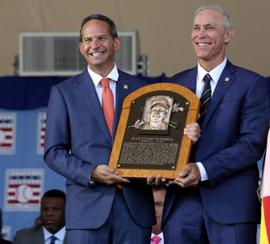 Jeff Idelson, President of the National Baseball Hall of Fame and Museum, presents to Tigers great Alan Trammell his Hall of Fame plaque on stage at the Clark Sports Center during the National Baseball Hall of Fame induction ceremony in Cooperstown, N.Y., on Sunday, July 29, 2018.