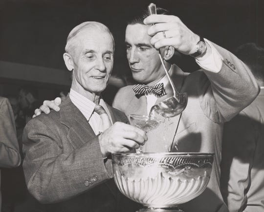 Ted Lindsay and his father celebrate with the Stanley Cup on April 23, 1954.