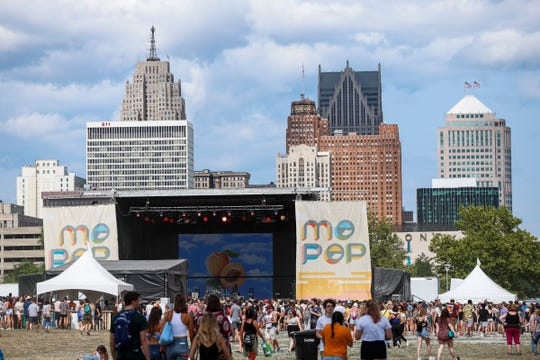 Festival goers make their way to the Grande Stage for Rex Orange County during Mo Pop Festival at West Riverfront Park in Detroit, Saturday, July 28, 2018.