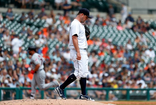 Tigers pitcher Jordan Zimmermann walks to the mound after allowing a Yonder Alonso two-run home run in the third inning on Sunday, July 29, 2018, at Comerica Park.