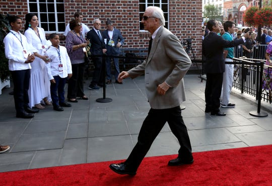 Detroit Tigers great Al Kaline walks down the red carpet into the National Baseball Hall of Fame on Main Street in Cooperstown, N.Y., on Saturday, July 28, 2018.