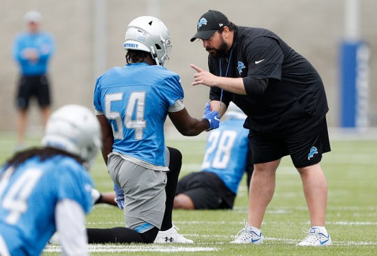Detroit Lions head coach Matt Patricia talks with linebacker Steve Longa during training camp in Allen Park, July 27, 2018.