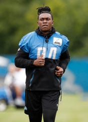 Detroit Lions defensive end Ziggy Ansah does light jogging during training camp in Allen Park on July 27, 2018.