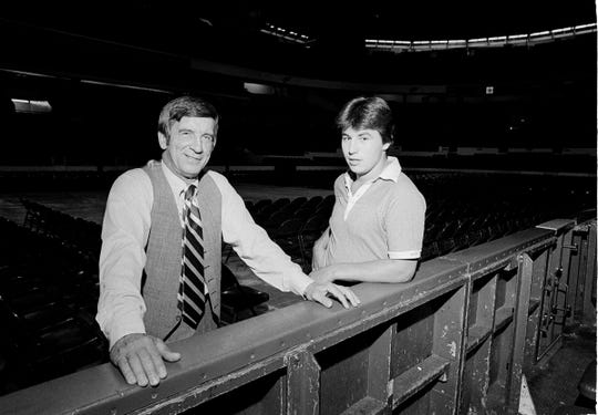 Red Wings general manager Ted Lindsay, left, and Wings center Dale McCourt pose on the edge of the rink in Olympia Stadium on Sept. 20, 1978, before McCourt's departure to Wings training camp in Kalamazoo.