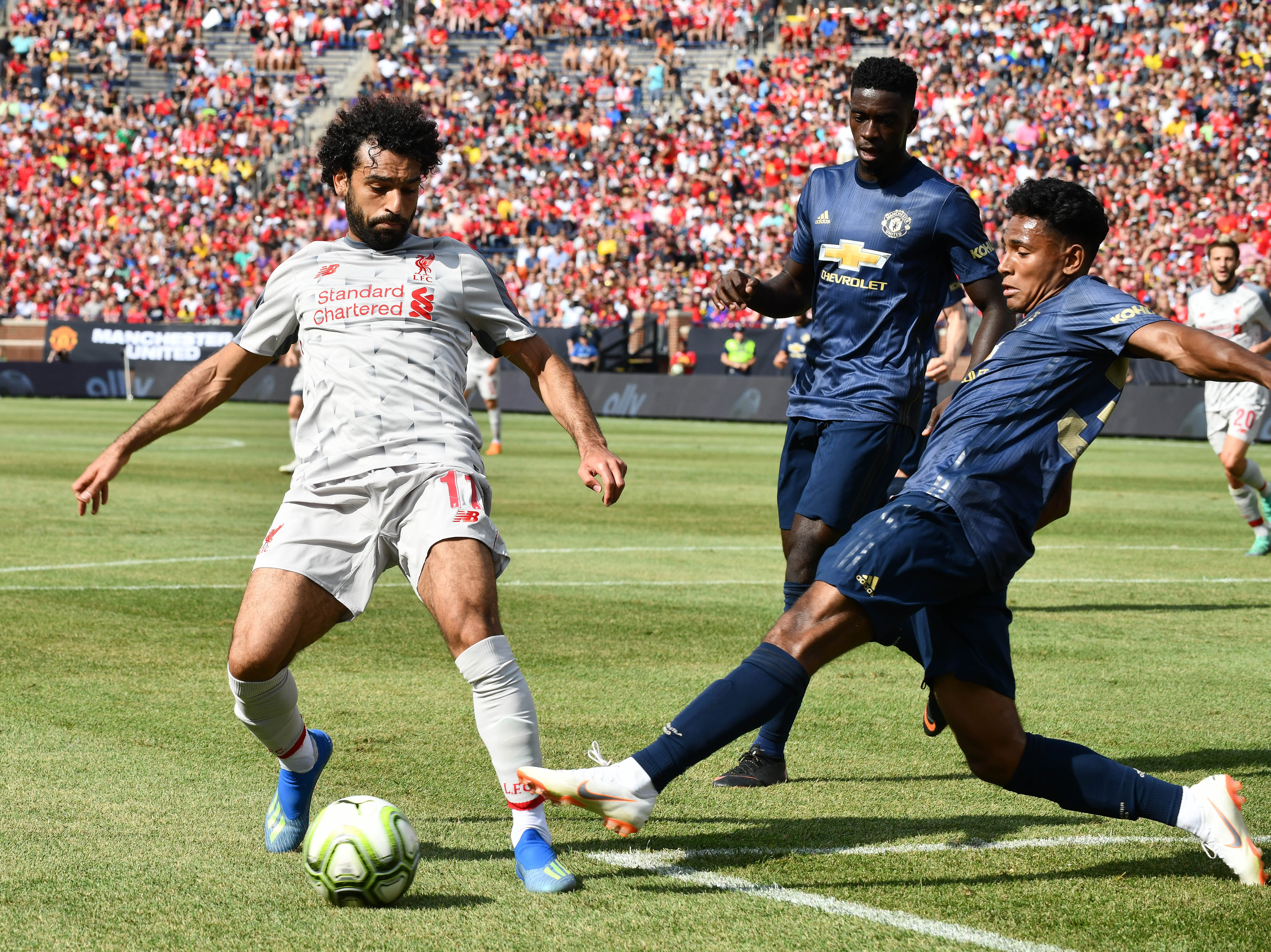 Liverpool's Mohamed Slah Chas down a loose ball in front of Manchesters net with Demetri Mitchell defending in the first half.