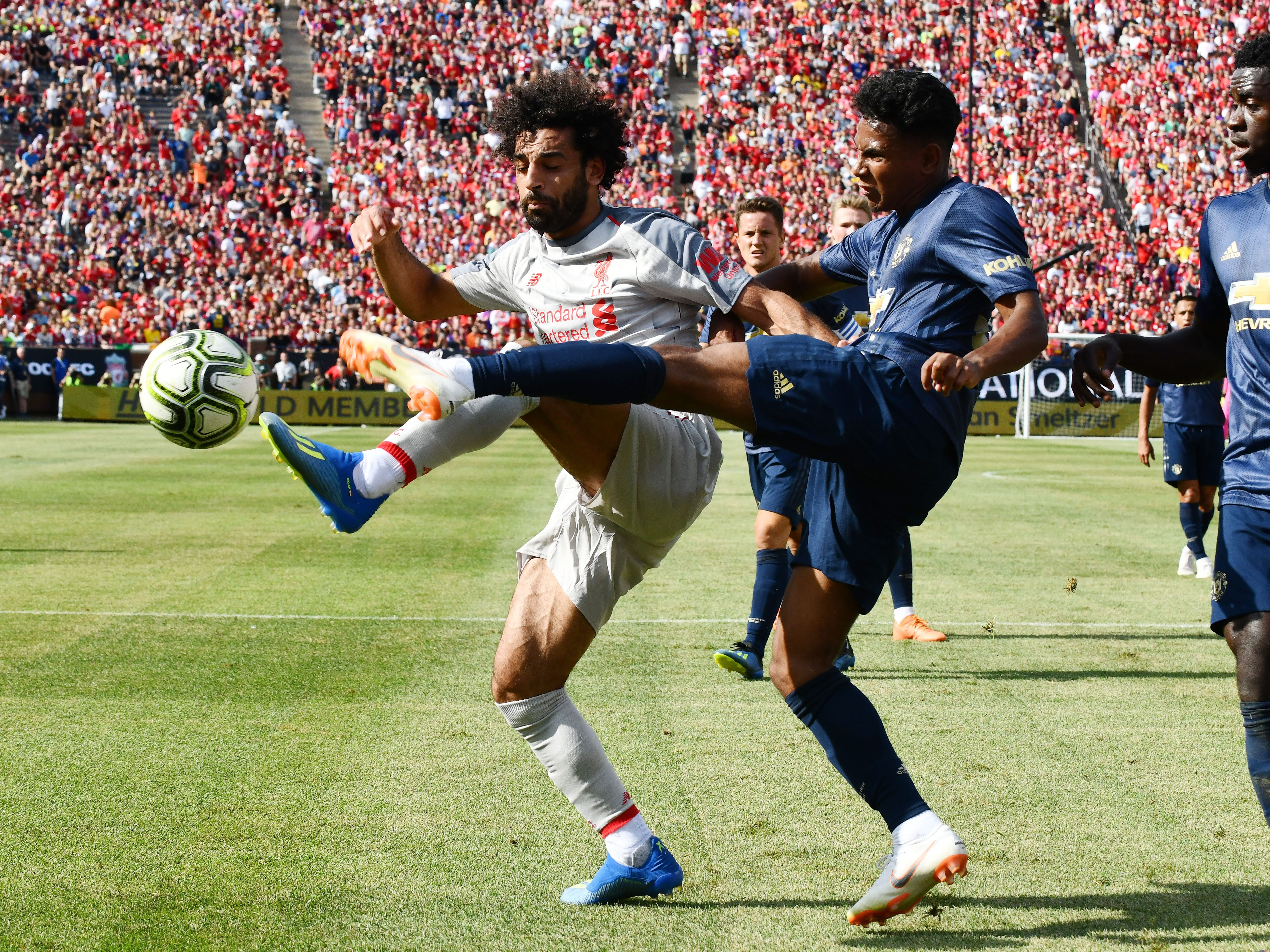 Liverpool's Mohamed Salah gets kicked in the face by Manchester United's Demetri Mitchell, giving Liverpool a penalty kick, putting Liverpool on the board first in the first half.