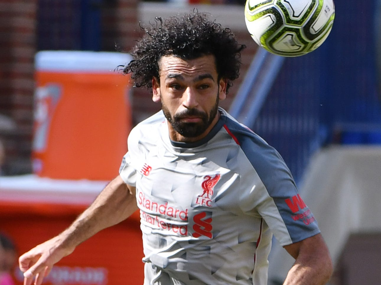 Liverpool's Mohamed Salah keeps an eye on the ball bringing it up field in the first half.