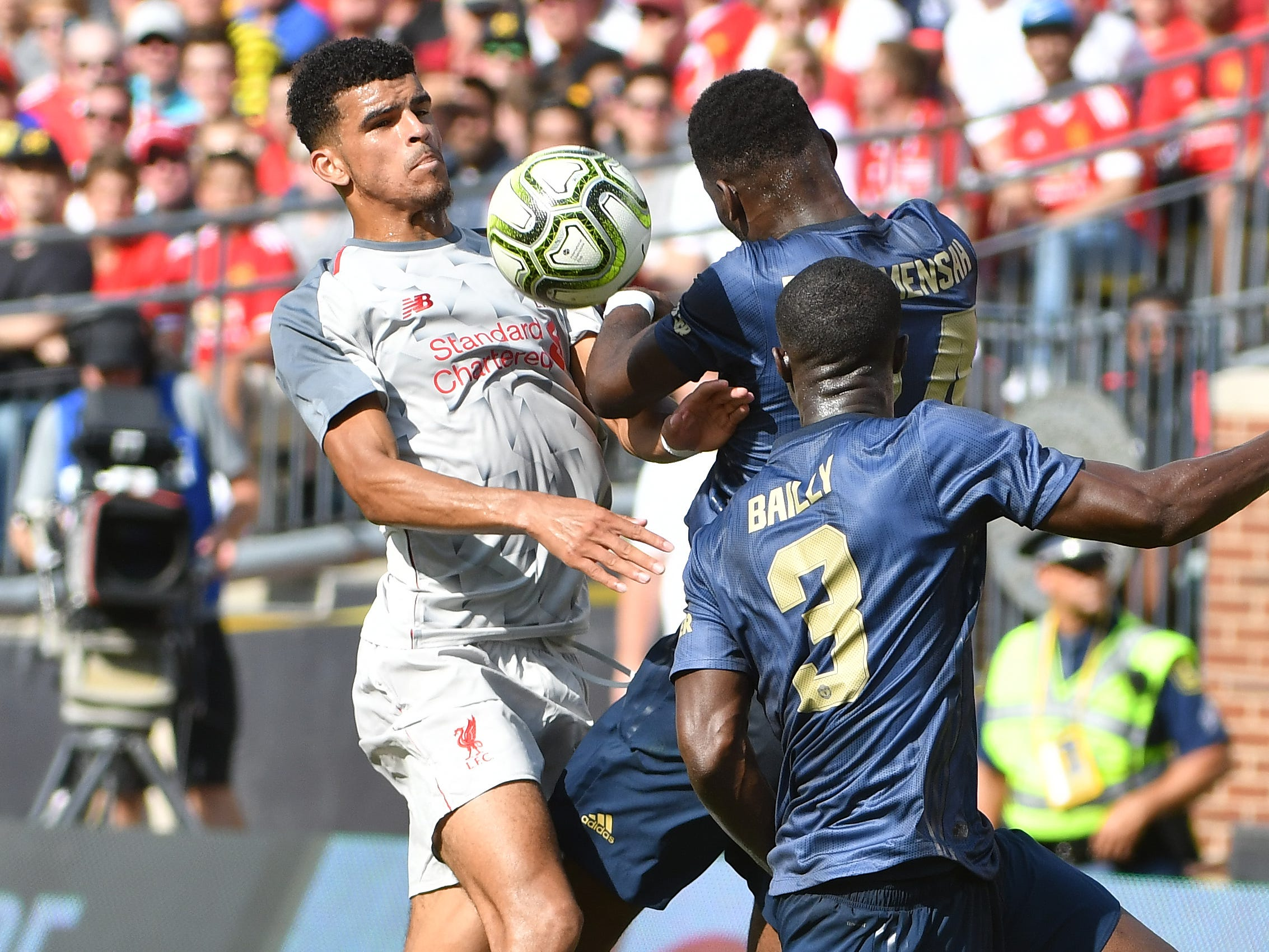 Liverpool's Dominic Solanke and Liverpool's Timothy Fosu-Mensah battle for a ball in the first half.