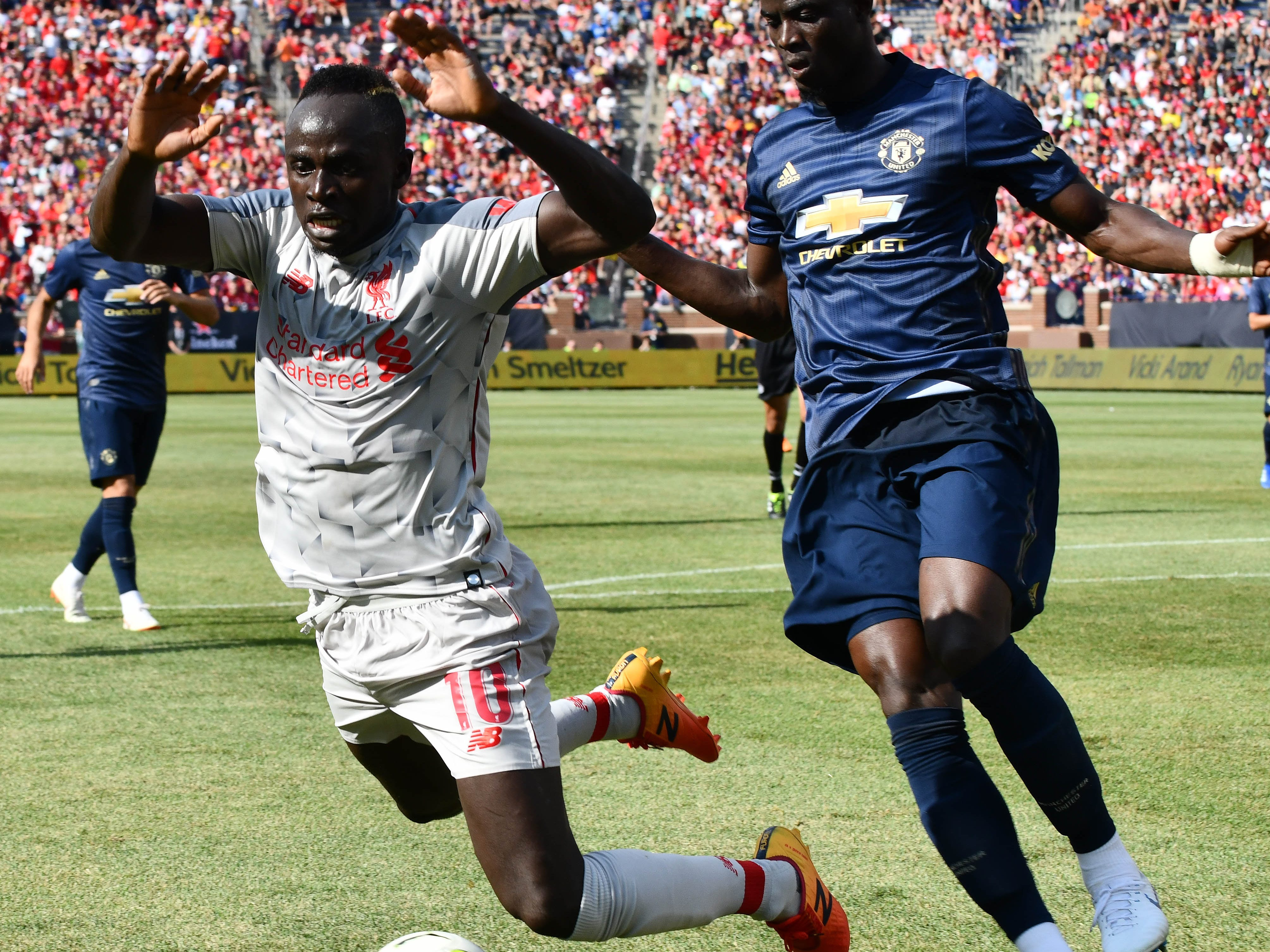 Liverpool's Said Mane' is taken off his feet by Manchester's Eric Bailly in the first half.