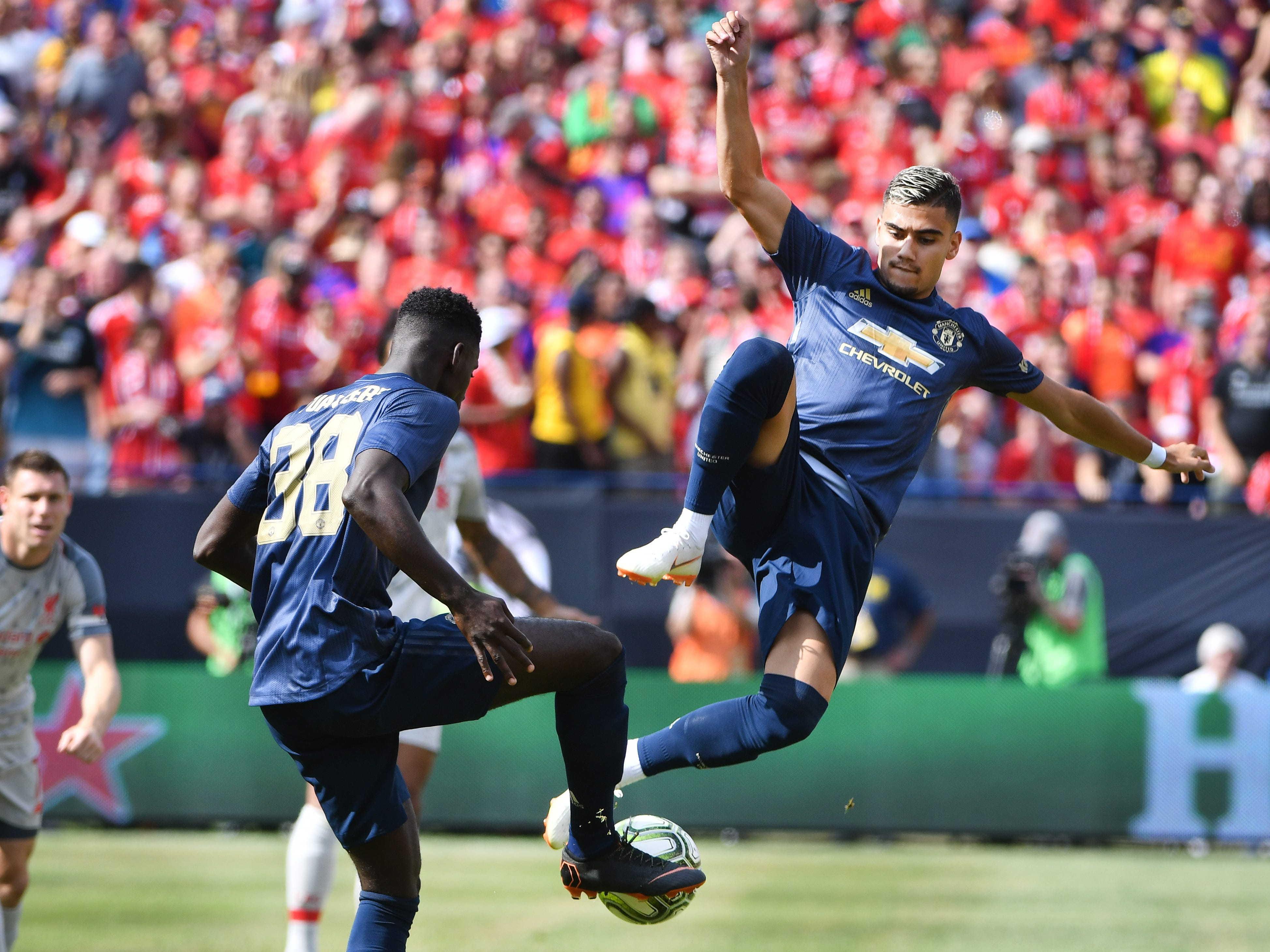 Manchester's Andreas Pereira gets some air trying to bring down a ball with teammate Axel Tuanzebe in the first half.