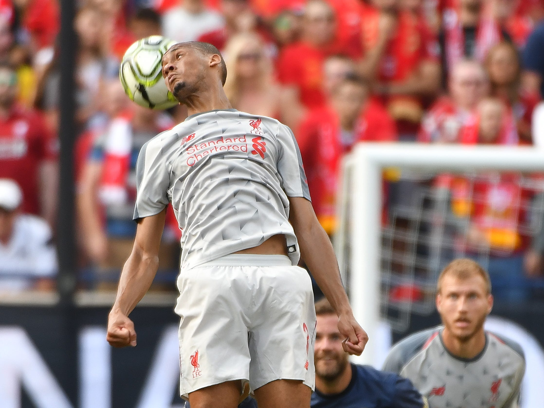 Liverpool's Fabinho heads back a ball in the first half.