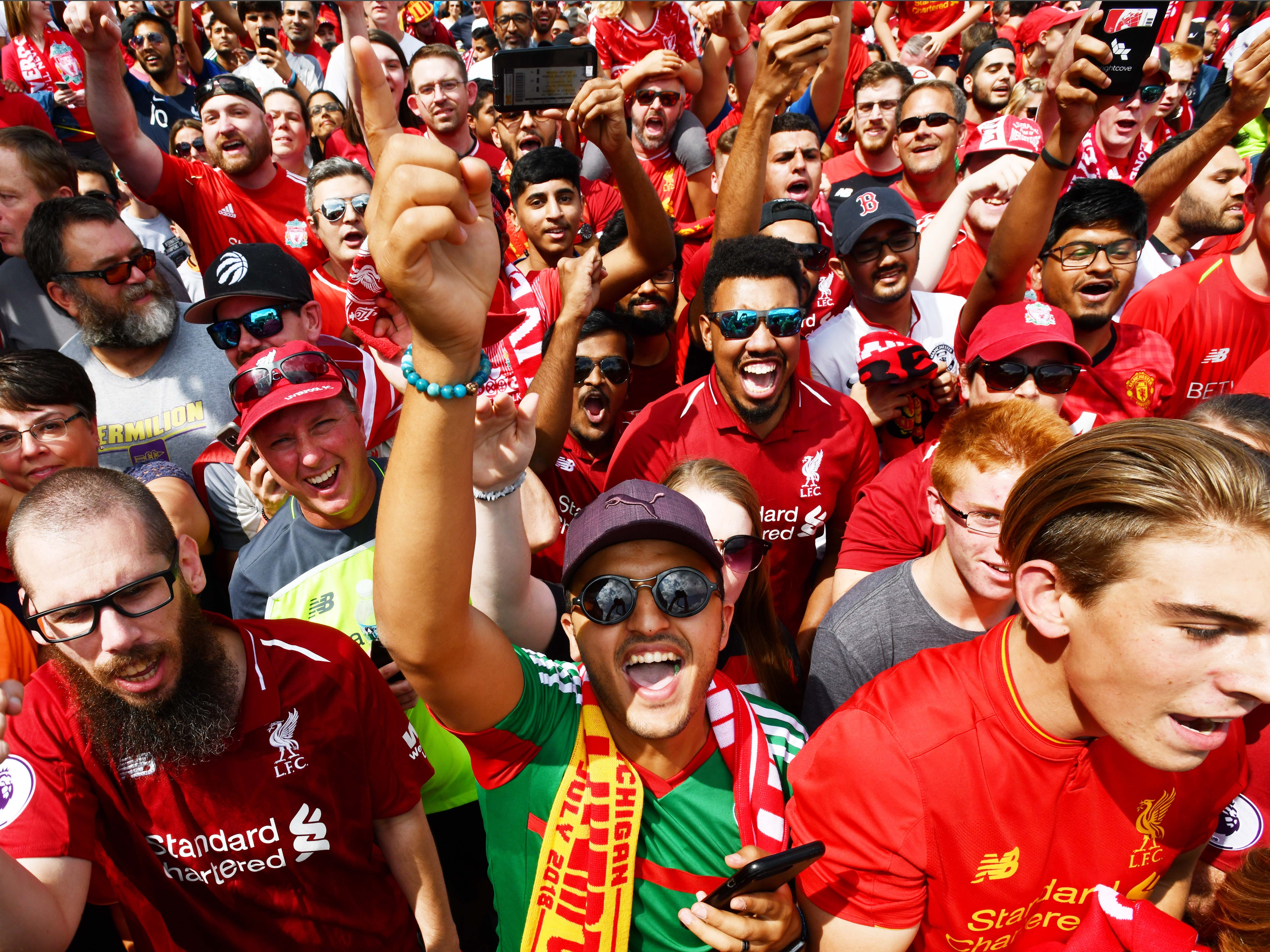 Manchester United and Liverpool fans cheer as they make their way into the stadium for the International Champions Cup match with Manchester United vs. Liverpool at Michigan Stadium.