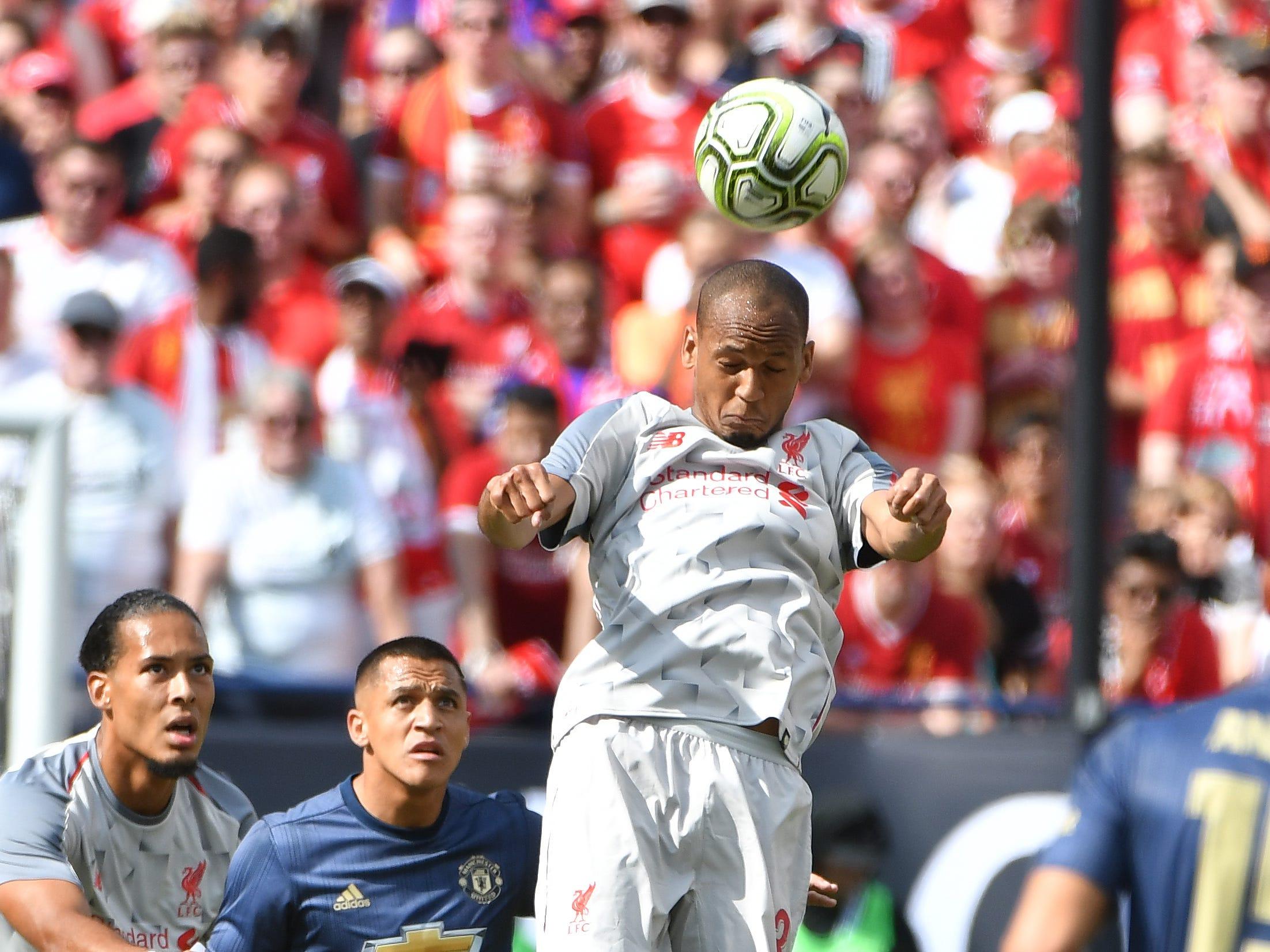 Liverpool's Fabinho heads a goalie kick back up field in the first half.