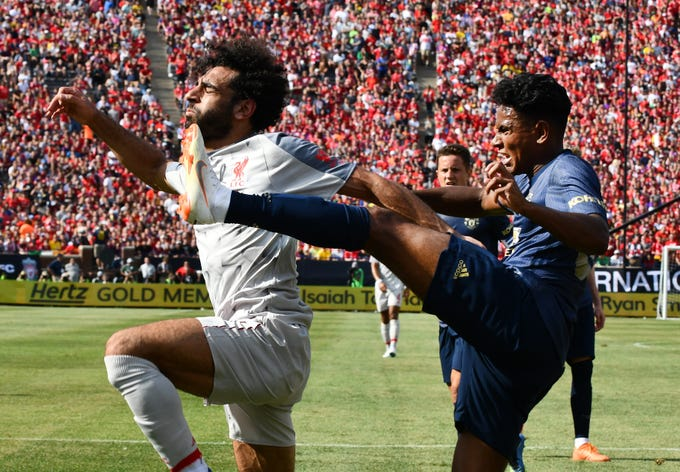 Liverpool's Mohamed Salah gets kicked in the face by Manchester United's Demetri Mitchell, giving Liverpool a penalty kick, putting Liverpool on the board first in the first half.  International Champions Cup Manchester United vs. Liverpool at Michigan Stadium on the campus of University of Michigan in Ann Arbor, Michigan on July 28, 2018.