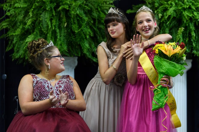"Ali Shanks, left, who was named Miss Compassionate, congratulates her friends Heather Benford, center, Miss Congeniality, and Shelby Buckwinkel, right, 2018 Miss Golden, after the pageant crowning ceremony inside the Vanderburgh 4-H Center Auditorium in Evansville, Ind., Saturday evening, July 28, 2018. ""This pageant is a dream come true,"" Shanks said, after competing in the pageant for the past four years. ""I keep coming back [to this pageant] because I love that they accept you for who you are."""