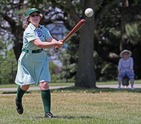 Michelle Gnadt of Milwaukee, a member of the Kenosha Comets, hits the ball.