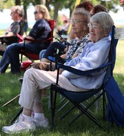 Joyce Hill Westerman (foreground) of Kenosha watches the game. She played for several teams in the All-American Girls Professional Baseball League from 1945-1952. Her neighbor Dorothy Martin of Kenosha looks on.